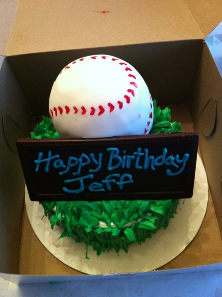 The man had a baseball cake for his birthday. I mean, this shows dedication... and a deep love for all things cake.